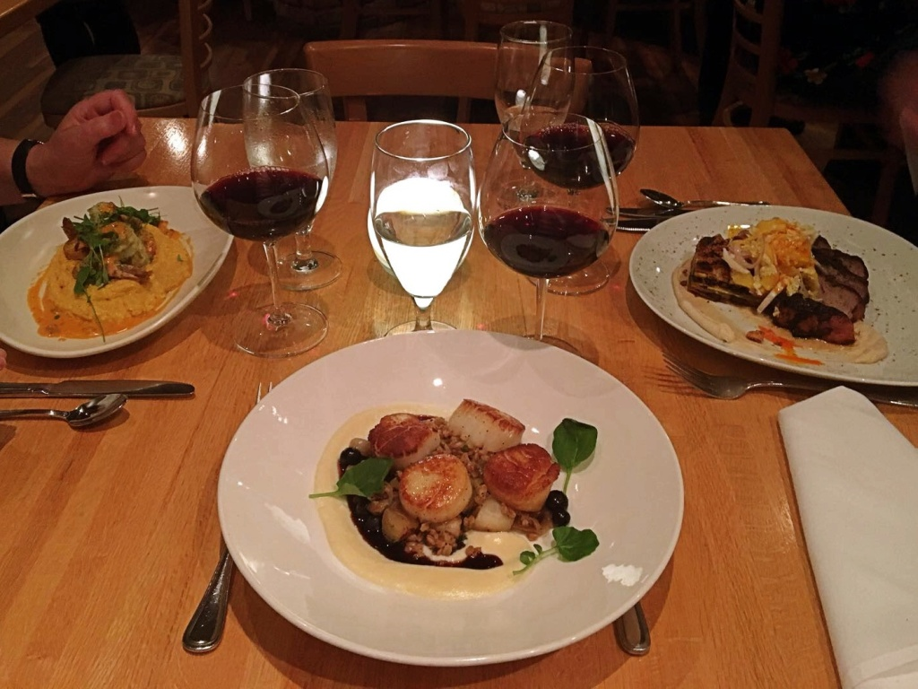 Dinner table with food and wine at the Fat Snook in Cocoa Beach, Florida.